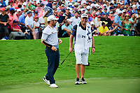 Louis Oosthuizen (RSA) shares a smile with his caddie after sinking a lengthy putt on 18 during Sunday's final round of the PGA Championship at the Quail Hollow Club in Charlotte, North Carolina. 8/13/2017.<br /> Picture: Golffile | Ken Murray<br /> <br /> <br /> All photo usage must carry mandatory copyright credit (&copy; Golffile | Ken Murray)
