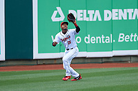 Lansing Lugnuts left fielder Mc Gregory Contreras (25) during a Midwest League game against the Wisconsin Timber Rattlers at Cooley Law School Stadium on May 1, 2019 in Lansing, Michigan. Wisconsin defeated Lansing 8-3 after the game was suspended from the previous night. (Zachary Lucy/Four Seam Images)