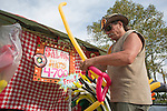 Robert Lockheed, an artist-in-residence at Collaborative Art International in Athens, Ohio, makes balloon hats at the Pawpaw Festival at Lake Snowden on Sept. 16, 2016.