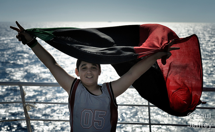 Thirteen-year old Rahib Jumagargo waves the Libyan flag upon arriving by ship back to his home of Misrata. For Libya's rebels, the tricolor flag (used between 1951 and 1969) has replaced the all-green flag of Moammar Gadhafi's government.