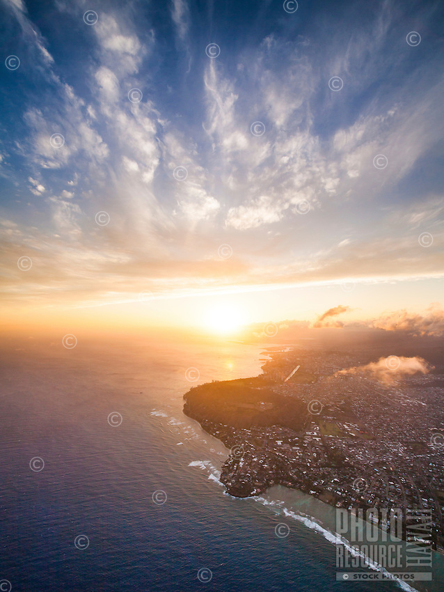 An aerial view of Black Point (with a misty Diamond Head just beyond it) along the Gold Coast of Kahala, Honolulu, O'ahu.