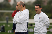 USMNT Head Coach Bob Bradley (l) observes training alongside Assistant Coach Peter Nowak (r)..