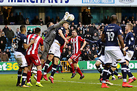 Millwall goalkeeper, Jordan Archer, punches the ball clear to foil a Brentfotd attack during Millwall vs Brentford, Sky Bet EFL Championship Football at The Den on 10th March 2018