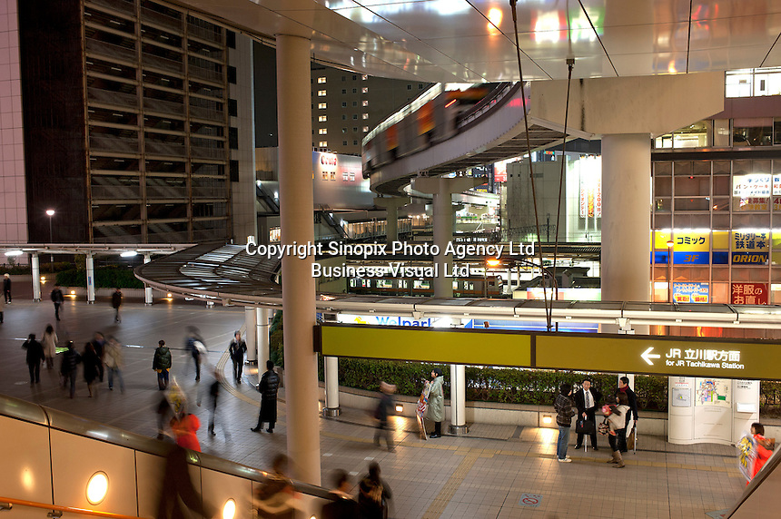 A monorail crosses a railway station in Tachikawa on the fringes of Tokyo, the biggest and most populated city in the world with 35 million people.<br /> <br /> Richard Jones  /  Sinopix