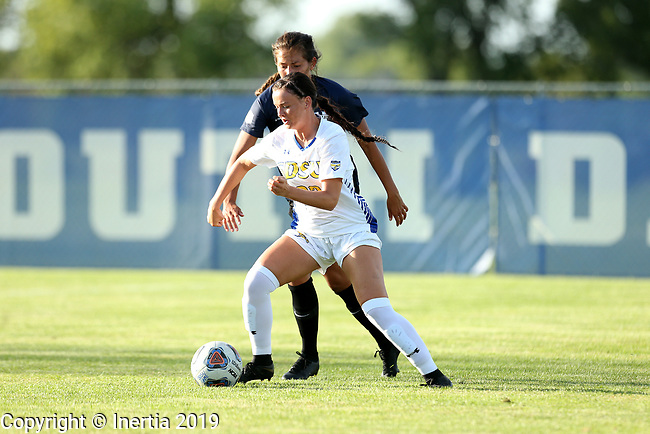 BROOKINGS, SD - AUGUST 23: Eden Brooker #23 from South Dakota State University controls the ball in front of a defender from Utah State during their match Friday evening at Fischback Soccer field in Brookings. (Photo by Dave Eggen/Inertia)