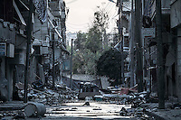 In this Tuesday, Oct. 30, 2012 photo, destroyed buildings are viewed along a desolated street in the nearby Bustan Al-Pasha district after several weeks of intense battles between rebel fighters and the Syrian army in Aleppo, the Syrian's largest city. (AP Photo/Narciso Contreras).