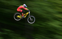 Canadian downhill mountain biker Steve Smith takes to the air during his qualification run during the UCI mountain bike world cup at Mont-Sainte-Anne in Beaupre, Quebec, on Friday, July 31, 2015. This is the 25th consecutive year the Mountain Bike World Cup has been held at Mont-Sainte-Anne. THE CANADIAN PRESS/Sean Kilpatrick