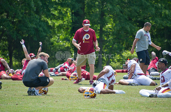 Washington Redskins head coach Jay Gruden looks on as his team participates in an organized team activity (OTA) at Redskins Park in Ashburn, Virginia on Wednesday, June 1, 2016.<br /> Credit: Ron Sachs / CNP/MediaPunch ***FOR EDITORIAL USE ONLY***
