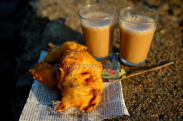 Street food (pakora, fritters) and tea of one of the typical small mobile tea shops, Fort Cochin (Kochi), Kerala.