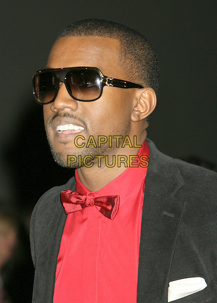 KANYE WEST.At the Louis Vuitton Gala Celebrating Murakami Exhibition held at the Geffen Contemporary at Moca, Los Angeles, California, USA, 28 October 2007..portrait headshot bow tie red shirt suit sunglasses .CAP/ADM/RE.©Russ Elliot/AdMedia/Capital Pictures.