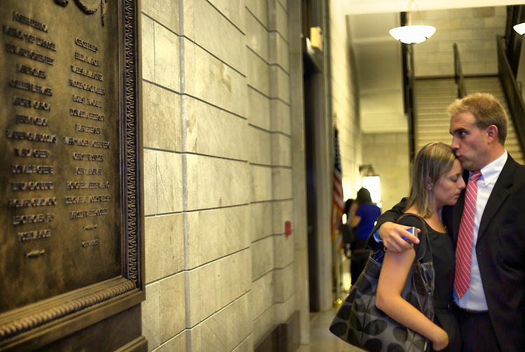 WASHINGTON, DC - September 9: Family members mourn their loved ones beside the newly unveiled plaque in the Capitol honoring the sacrifice of the victims of the hijacking of United Flight 93 on September 11, 2001. (Photo by Ryan Kelly/Congressional Quarterly)