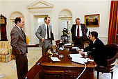 United States President Ronald Reagan, right, meets with White House Aides Edwin Meese, III, right center, James A. Baker, III, left center, and Michael Deaver, left, in the Oval Office of the White House in Washington, D.C. on Friday, April 24, 1981..Mandatory Credit: Michael Evans - White House via CNP