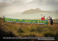 Family ties....Former Kerry football player and team manager Paidi O'Se and his son Padraig erect a banner supporting Kerry ahead of next Sunday's All-Ireland final against Dublin. Paidi predicts Dublin to beat Kerry also believes that his nephew, recently retired Kerry midfielder Darragh O'Se would make an excellent president in the future..Picture by Don MacMonagle