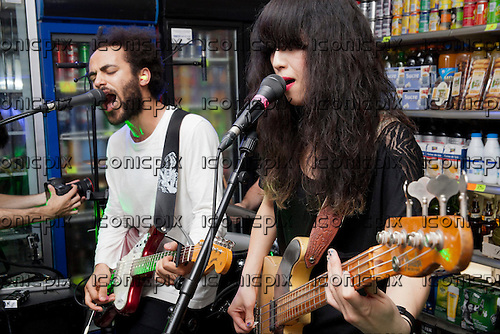 YUCK - guitarist Ed Hayes and bassist Mariko Doi - performing a free concert for the <br /> Converse Get Loud campaign at the Converse store in Paris France - 29 Sep 2013.  Photo <br /> credit: Michela Cuccagna/Dalle/IconicPix