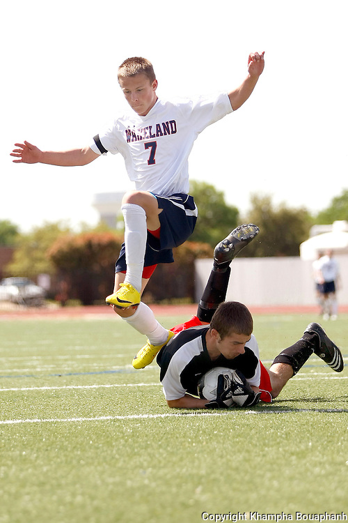 Kilgore's goal keeper Corey Thompson goes after the ball against Frisco Wakeland's Hayden Partain in a region II 4A boys high school soccer in Carrollton on April 3, 2010.  Wakeland won 2-0.  (photo by Khampha Bouaphanh)