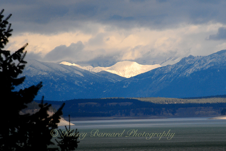 Snow capped Canadian Rockies in British Columbia looking across Lake Koocanusa in Montana