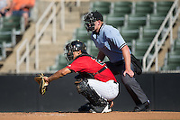 Kannapolis Intimidators catcher Seby Zavala (21) sets a target as home plate umpire Mike Carroll looks on during the game against the Greenville Drive at Intimidators Stadium on June 7, 2016 in Kannapolis, North Carolina.  The Drive defeated the Intimidators 4-1 in game one of a double header.  (Brian Westerholt/Four Seam Images)