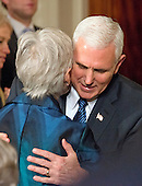 United States Vice President Mike Pence hugs Maureen Scalia, widow of Justice Antonin Scalia prior to US President Donald J. Trump announcing Judge Neil Gorsuch as his nominee to be Associate Justice of the US Supreme Court in the East Room of the White House in Washington, DC on Tuesday, January 31, 2017.<br /> Credit: Ron Sachs / CNP