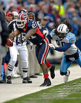 24 December 2006: Buffalo Bills running back Willis McGahee (21) in action against the Tennessee Titans is tackled by safety Lamont Thompson (28) at Ralph Wilson Stadium in Orchard Park, New York. The Titans edged out the Bills 30-29... ..Mandatory Photo Credit: Ed Wolfstein Photo<br />