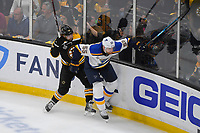 June 6, 2019: Boston Bruins left wing Jake DeBrusk (74) and St. Louis Blues defenseman Colton Parayko (55) collide during game 5 of the NHL Stanley Cup Finals between the St Louis Blues and the Boston Bruins held at TD Garden, in Boston, Mass. Eric Canha/CSM