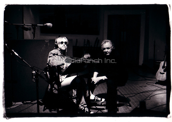 Tom Petty and Johnny Cash in the recording studio laying tracks for the album UNCHAINED in Van Nuys, California, 1996.  Credit: Kevin Estrada / MediaPunch ***HIGHER RATES APPLY***
