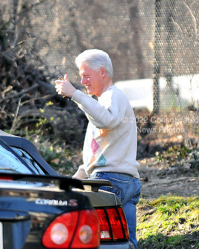 Former United States President Bill Clinton gives a thumbs -up as he and his wife, United States Senator Hillary Rodham Clinton (Democrat of New York), not pictured,  leave for a late afternoon walk near their home in Washington, D.C. on Wednesday, March 5, 2008.  Senator Clinton is in her Washington, D.C. home after her primary victories in Ohio, Rhode Island, and Texas last evening.<br /> Credit: Ron Sachs / CNP<br /> (RESTRICTION: NO New York or New Jersey Newspapers or newspapers within a 75 mile radius of New York City)