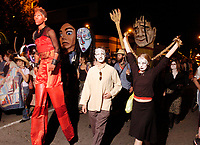 Participants walk in the All Souls' Procession on East Congress Street Sunday night. About 3000 people took park in the procession.