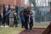 US President Barack Obama (Front) and US First Lady Michelle Obama (Back) arrive with children to play on 'Malia and Sasha's Castle', a play-set that was formerly used by the Obama children at the White House and donated by the Obama family, during a service event for Martin Luther King Jr. Day at the Jobs Have Priority Naylor Road Family Shelter in Washington, DC, USA,16 January 2017.<br /> Credit: Michael Reynolds / Pool via CNP