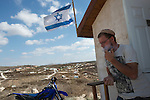 Yosef at his house, in the unauthorized Israeli settler-outpost of Chavat Gilad, West Bank.