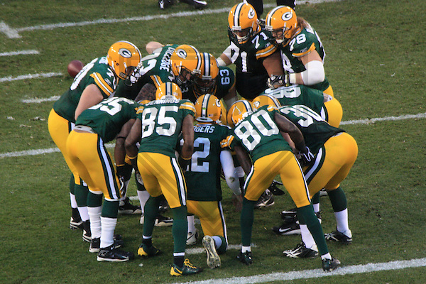 GREEN BAY - NOVEMBER 2009: The Green Bay Packers huddle up during a game on November 1, 2009 at Lambeau Field in Green Bay, Wisconsin. (Photo by Brad Krause)