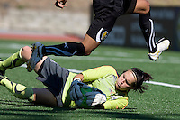 Erin Mcleod of Freedom makes a save from Gold Pride's Marta's kick during the game against Gold Price at Pioneer Stadium in Hayward, California.  Gold Pride defeated Washington Freedom, 3-2.