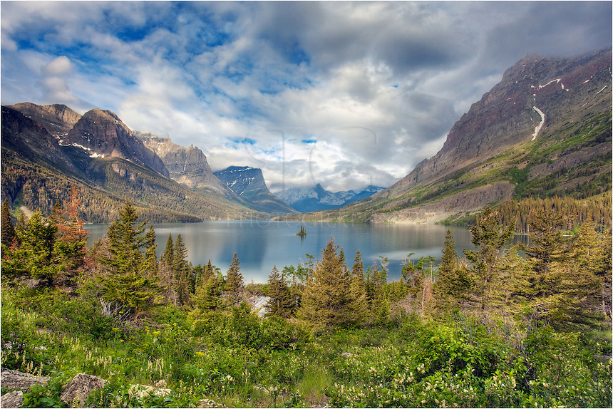 On a calm morning, this image from the Rocky Mountains shows the view of Saint Mary's Lake and the iconic Wild Goose Island. The morning was calm and the skies were beautiful on this morning, and the landscape was absolutely stunning. Wish it wasn't so far from my home!