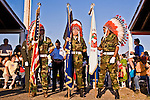 The flag bearers wait to lead the color guard for the Grand Entry of the eventing powwow at Crow Fair.