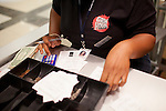 Akiya Nellom tallies up the contents of a register at the end of a day at Grindhouse Killer Burgers in Terminal A at Hartsfield–Jackson Atlanta International Airport, in Atlanta, Georgia on August 28, 2013.