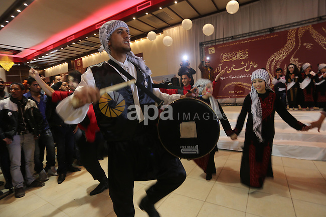 "Palestinians participate in the opening of an exhibition of Palestinian heritage entitled ""products of our women"", in Gaza City, on March 16, 2015. Photo by Mohammed Asad"