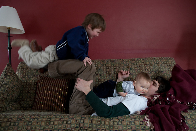 My husband horseplays with both boys, three and a half and nine months, in our living room.