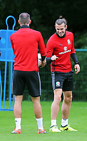(L-R) Joe Ledley and Gareth Bale in action during the Wales Training Session at the Vale Resort, Hensol, Wales, UK. Tuesday 29 August 2017
