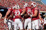 Wisconsin Badgers running back Jonathan Taylor (23) celebrates a touchdown with teammates during an NCAA Big Ten Conference football game against the Maryland Terrapins Saturday, October 21, 2017, in Madison, Wis. The Badgers won 38-13. (Photo by David Stluka)