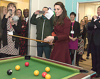 22 February 2017 - Prince Kate Duchess of Cambridge Duchess of plays pool during a visit Action for Children projects supporting vulnerable families in Wales. This will be her first engagements with Action for Children since becoming its Patron in December, following on from Her Majesty The Queen. The Duchess visiting Torfaen to see MIST, a child and adolescent mental health project which works specifically with children who are living in care with foster families or birth families. Photo Credit: ALPR/AdMedia