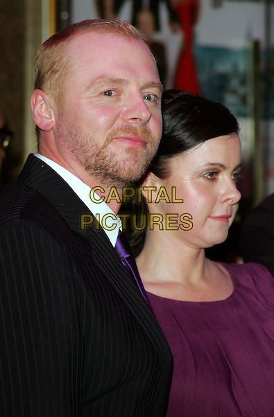 "SIMON PEGG & MAUREEN McCANN.World Premiere of ""How to Lose Friends and Alienate People"" at the Empire, Leicester Square, London, England, .September 24th 2008.portrait headshot tie beard facial hair black suit purple .CAP/ROS.©Steve Ross/Capital Pictures"