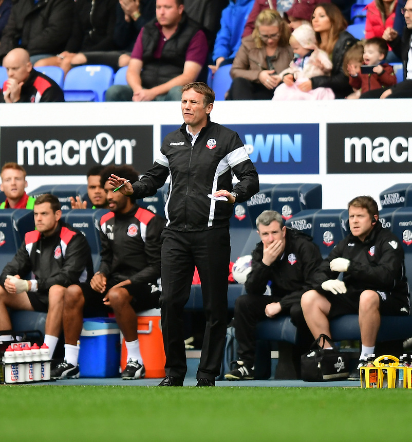 Bolton Wanderers's Manager Phil Parkinson shouts instructions to his team from the dug-out<br /> <br /> Photographer Chris Vaughan/CameraSport<br /> <br /> Football - The EFL Sky Bet League One - Bolton Wanderers v Fleetwood Town - Saturday 20 August 2016 - Macron Stadium - Bolton<br /> <br /> World Copyright &copy; 2016 CameraSport. All rights reserved. 43 Linden Ave. Countesthorpe. Leicester. England. LE8 5PG - Tel: +44 (0) 116 277 4147 - admin@camerasport.com - www.camerasport.com