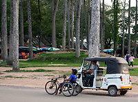 Different types of transportation a modified bike driven by handpower, for the disabled near Angkor Wat, Cambodia