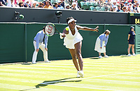 Venus Williams (USA) in aciton during her first round match against Johanna Larsson (SWE)<br /> <br /> Photographer Rob Newell/CameraSport<br /> <br /> Wimbledon Lawn Tennis Championships - Day 1 - Monday 2nd July 2018 -  All England Lawn Tennis and Croquet Club - Wimbledon - London - England<br /> <br /> World Copyright &not;&uml;&not;&copy; 2017 CameraSport. All rights reserved. 43 Linden Ave. Countesthorpe. Leicester. England. LE8 5PG - Tel: +44 (0) 116 277 4147 - admin@camerasport.com - www.camerasport.com