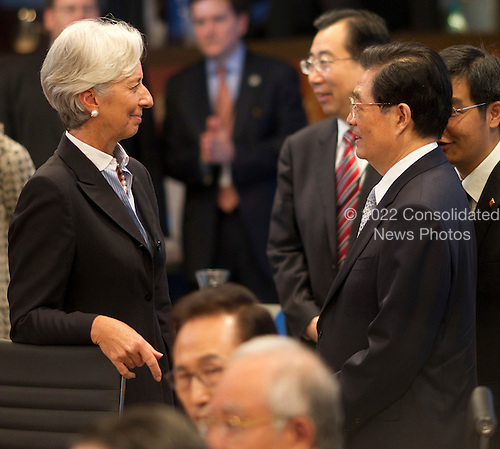 International Monetary Fund Chief Christine Lagarde talks with China President Hu Jintao at the Opening plenary session of the Asia-Pacific Economic Cooperation (APEC) summit at the J.W. Marriott Hotel in Honolulu, Hawaii on Sunday, November 13, 2011..Credit: Kent Nishimura / Pool via CNP