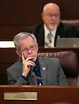 Nevada Assemblyman Glenn Trowbridge, R-Las Vegas, works in committee at the Legislative Building in Carson City, Nev., on Tuesday, April 7, 2015. <br /> Photo by Cathleen Allison