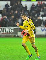 Pictured: Friday 26 December 2014<br /> Re: Premier League, Swansea City FC v Aston Villa at the Liberty Stadium, Swansea, south Wales, UK.<br /> <br /> Lukasz Fabianski celebrates the teams win against Aston Villa.