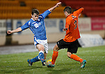 St Johnstone v Dundee Utd..10.11.15  SPFL Development League.  McDiarmid Park, Perth.<br /> Craig Thomson is tackled by Jamie Robson<br /> Picture by Graeme Hart.<br /> Copyright Perthshire Picture Agency<br /> Tel: 01738 623350  Mobile: 07990 594431
