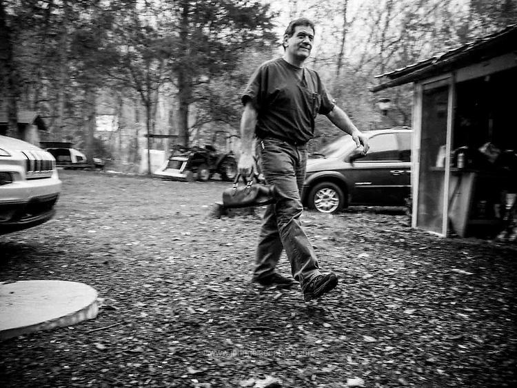 Physician Assistant Arthur Cerami of EA Hawse medical clinic in Mathias, West Virginia makes a house call.