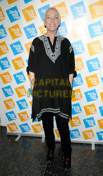 "ANNIE LENNOX .At the ""Equals On Film"" Gala Screening, Birds Eye View Film Festival, Institute of Contemporary Arts, The Mall, London, England, UK, 13th March 2011..full length black tunic white embroidered hands in pockets dress over trousers .CAP/CAN.©Can Nguyen/Capital Pictures."
