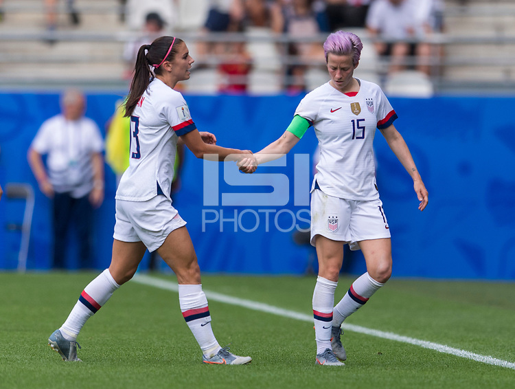 REIMS,  - JUNE 24: Alex Morgan #13 talks to Megan Rapinoe #15 as they come off the field during a game between NT v Spain and  at Stade Auguste Delaune on June 24, 2019 in Reims, France.